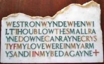 The photo is of a piece of artwork on marble done by Christina Fletcher, the poem etched without wordbreaks and without lin